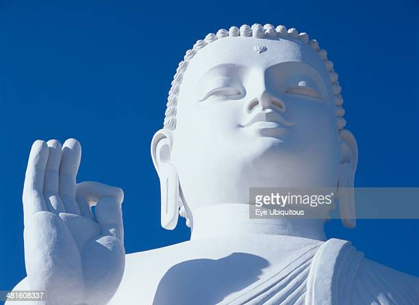 Sri Lanka Mihintale Large white seated Buddha head and raised hand