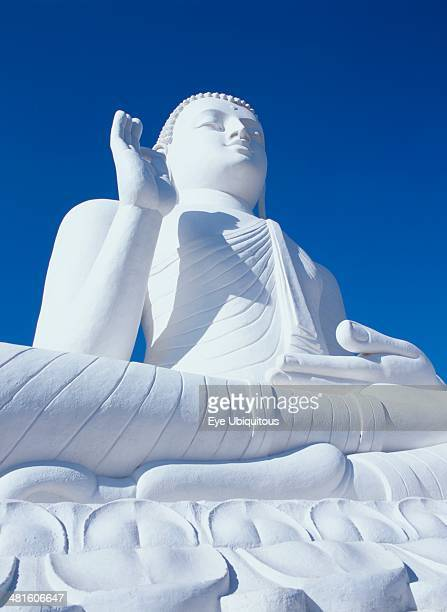 Sri Lanka Mihintale low Angled view of large white seated Buddha