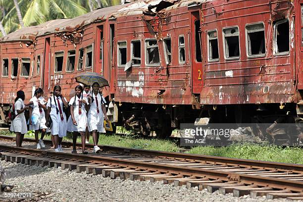 Sri Lanka Photo shows School girls walking past train carriages near Galle in southern Sri Lanka which were hit by the Tsunami More than a 1000...
