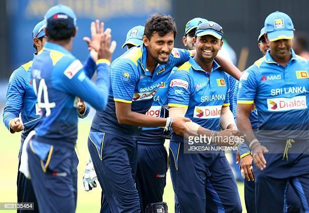 Sri Lanka players celebrate a good bowling innings during the opening match of an ODI series Sri Lanka vs Zimbabwe in Harare on November 14 2016 /...