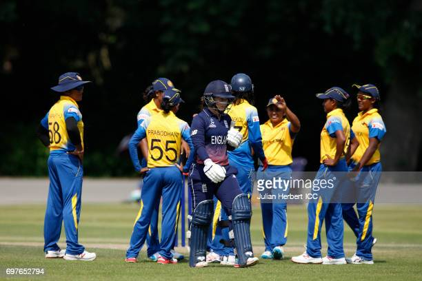 Sri Lanka players celebrate the wicket of Tamsin Beaumont of England during The ICC Women's World Cup warm up match between England and Sri Lanka at...