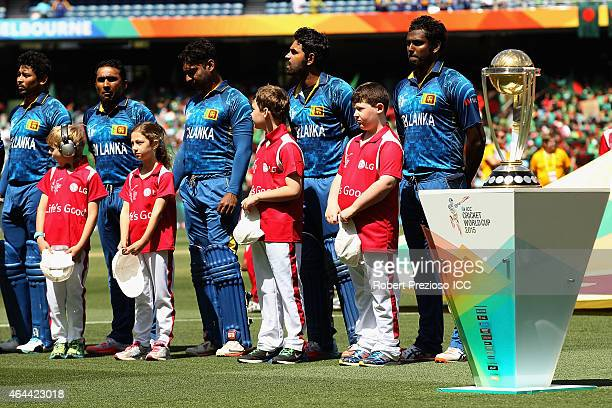 Sri Lanka players line up for national anthems during the 2015 ICC Cricket World Cup match between Sri Lanka and Bangladesh at Melbourne Cricket...