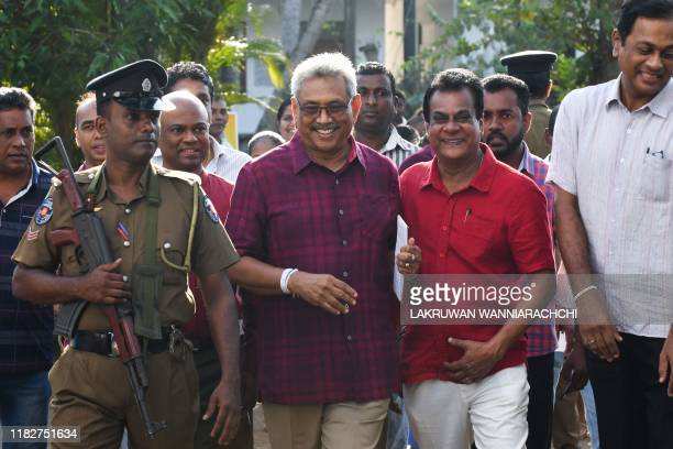 Sri Lanka Podujana Peramuna party presidential candidate Gotabaya Rajapaksa leaves a polling station after casting his vote during the country's...