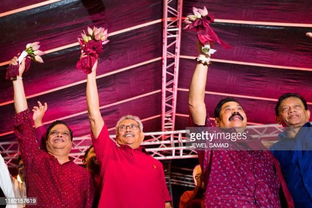 Sri Lanka Podujana Peramuna party presidential candidate Gotabhaya Rajapaksa and his brother, former Sri Lanka's president Mahinda Rajapaksa wave at...