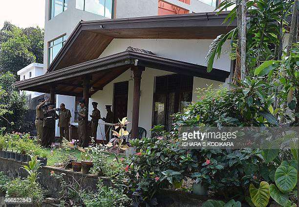 Sri Lanka police investigators conduct a probe at the home of murdered former Agence FrancePresse journalist Mel Gunasekera in the capital Colombo on...