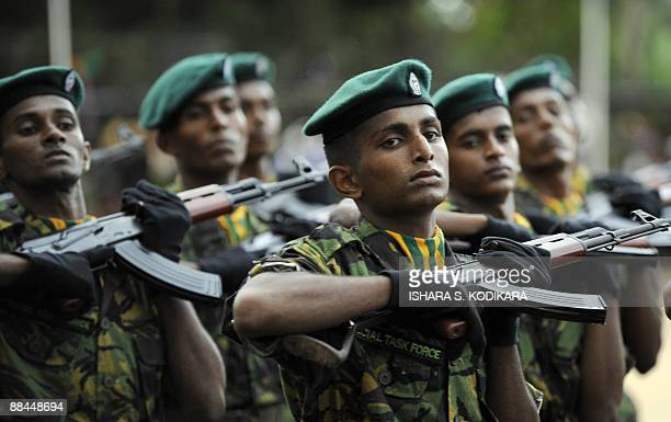 Sri Lanka Police Special Task Force commandos march during a passing out parade in Katukurunda some 40 km south of Colombo on June 12 2009 Sri Lankan...