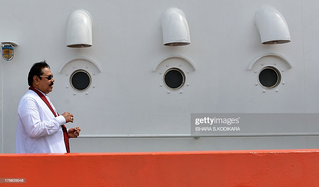 Sri Lanka President Mahinda Rajapakse travels aboard a tug-boat inside the Colombo harbour to ceremonially launch the Chinese-built Colombo International Container Terminal (CICT) in Colombo on August 5, 2013. Sri Lanka launched its biggest port with Chinese funding to turn Colombo into a strategic shipping hub along the world's most lucrative trading route. AFP PHOTO/ Ishara S. KODIKARA
