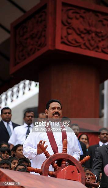 Sri Lanka President Mahinda Rajapakse turns a wheel at the site of a new port being built at the southern town of Hambantota on August 15 to allow...
