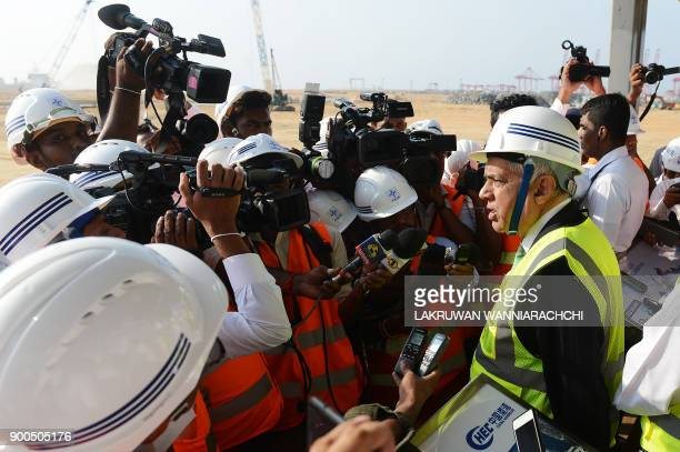 Sri Lanka Prime Minister Ranil Wickremesinghe addresses a press during a visit to the Chinesefunded $14 billion of reclamation land next to Colombo's...