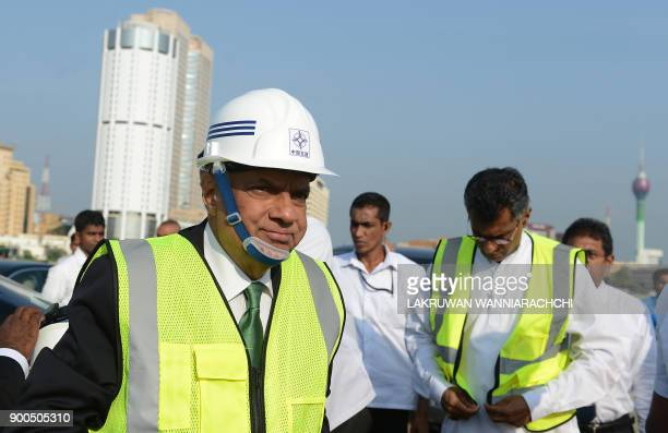 Sri Lanka Prime Minister Ranil Wickremesinghe inspects progress during a visit to the Chinesefunded $14 billion of reclamation land next to Colombo's...
