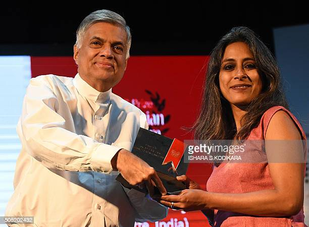 Sri Lanka Prime Minister Ranil Wickremesinghe presents the South Asian Literature prize to Anuradha Roy author of Sleeping on Jupiter during a...