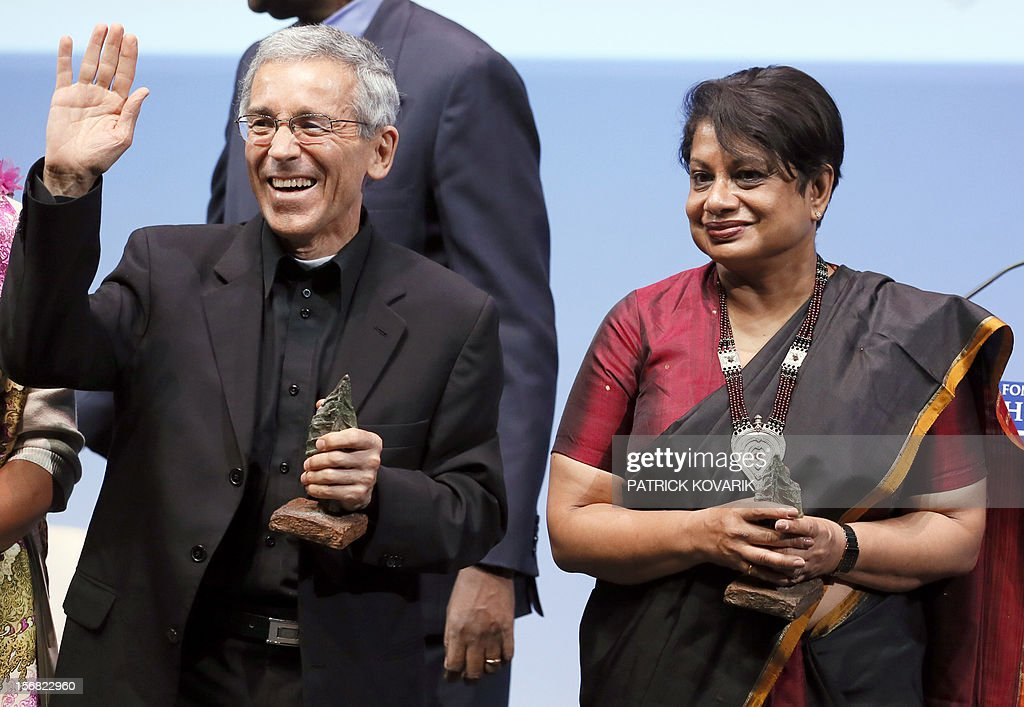Sri Lanka Radhika Coomaraswamy (R), laureate of the jury's special prize and Father Francisco de Roux, laureate for the prize for conflict prevention, celebrates during the ceremony of release of the Jacques Chirac Foundation's 2012 Award for the prevention of conflicts, on November 22, 2012 at the Quai Branly Museum in Paris.
