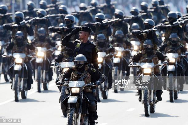 Sri Lanka Special Forces soldiers ride on bikes as they parade during Sri Lanka's 70th Independence Day celebrations in Colombo on February 4 2018...
