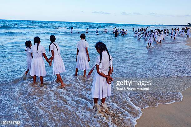 Sri Lanka, Trincomalee, shcool girls play on the sea