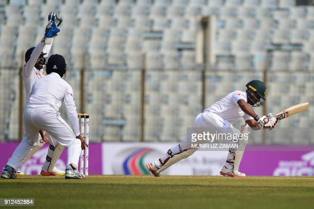 Sri Lanka wicketkeeper Niroshan Dickwella successfully appeals for a leg before wicket decision against Bangladesh cricketer Imrul Kayes during the...
