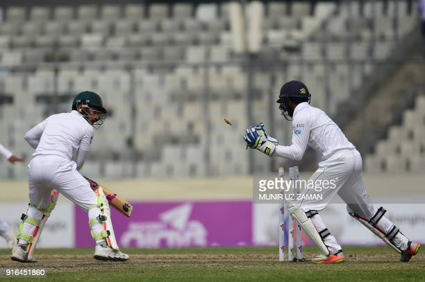 Sri Lanka wicketkeeper Niroshan Dickwella successfully breaks the stumps of the Bangladesh cricketer Mushfiqur Rahim during the third day of the...