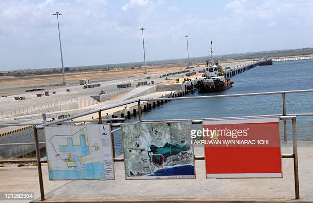 Sri Lankaeconomyportaviation FEATURE by Amal Jayasinghe In a picture taken on August 2 2011 a barge is berthed at the new port built with a Chinease...