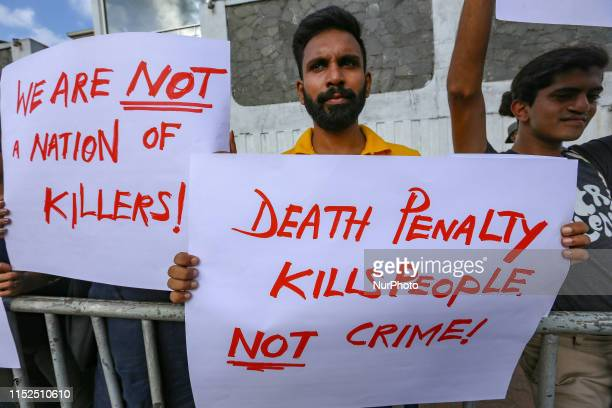 Sri Lankan activists hold a placards during a protest against the proposal to implement death penalty in front of the main prison Welikada at Colombo...