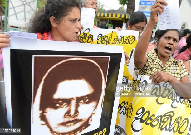 Sri Lankan activists hold up a portrait of Rizana Nafeek as they shout slogans during a protest in Colombo January 11 following her execution by...
