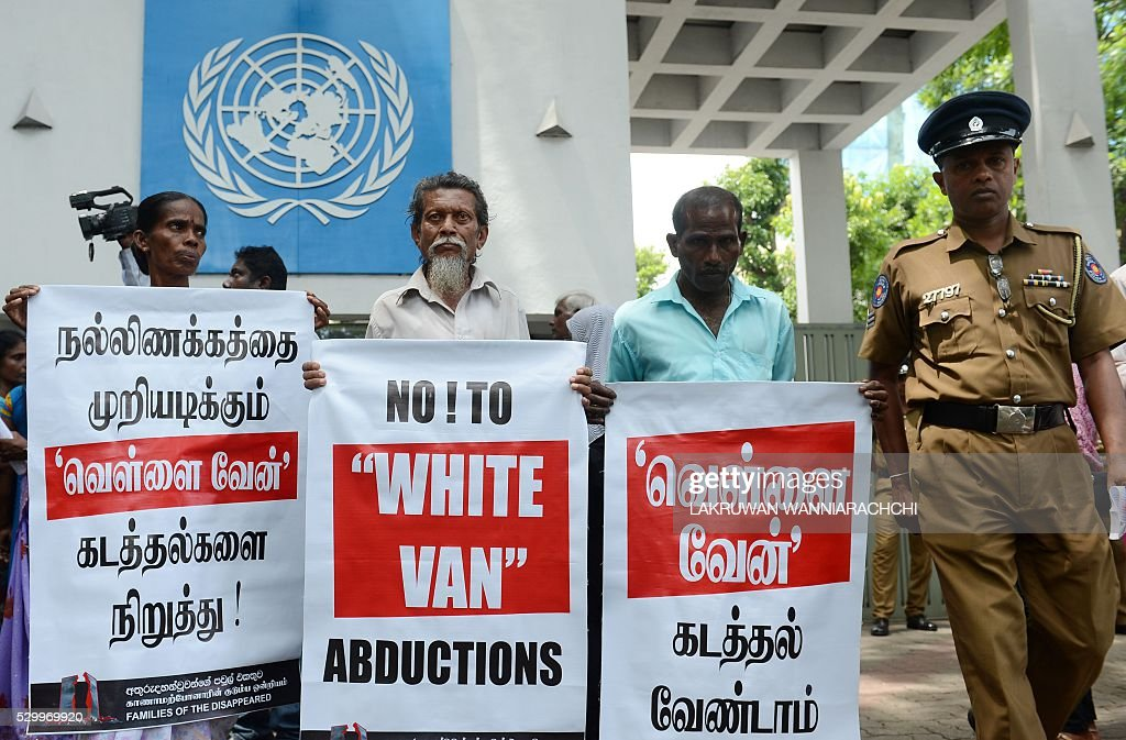 Sri Lankan activists of the 'Dead and Missing Person's Parents' organisation hold placards as they take part in a demonstration outside the United Nations offices in Colombo on May 10, 2016. UN officials have said they have been told that up to 22,000 people are still missing seven years after the end of Sri Lanka's Tamil separatist war in 2009. / AFP / LAKRUWAN