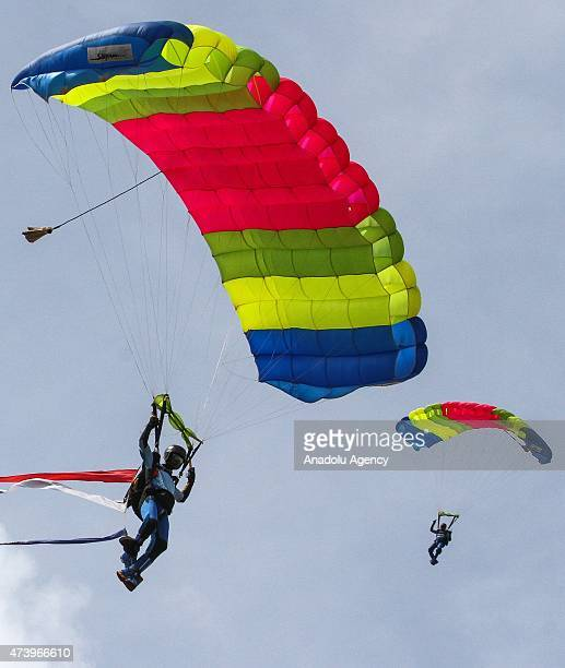 Sri Lankan Air Force paratroopers perform during the Victory Day parade in the southern coastal town of Matara 150 kilometers south of Colombo Sri...
