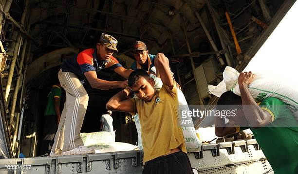 Sri Lankan Air Force personnel load emergency relief supplies onto an aeroplane in Colombo on August 7 to be despatched to Pakistan. Sri Lanka...