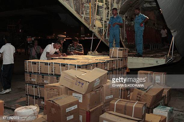 Sri Lankan Air Force personnel load emergency relief supplies to be flown to quakehit Nepal aboard a C130 heavy lift aircraft at the main...