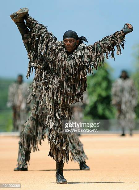 Sri Lankan Air Force troops display their commando skills during a passing out parade of 116 men and officers in the northeastern town of Trincomalee...