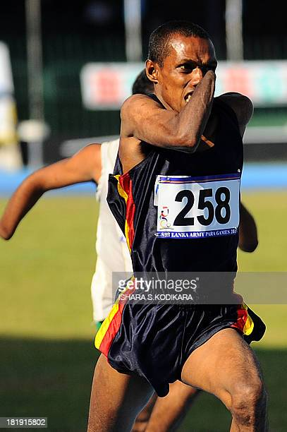 Sri Lankan amputees compete during an athletic event for disabled soldiers in Colombo on September 26 2013 Nearly 30000 government troops were...