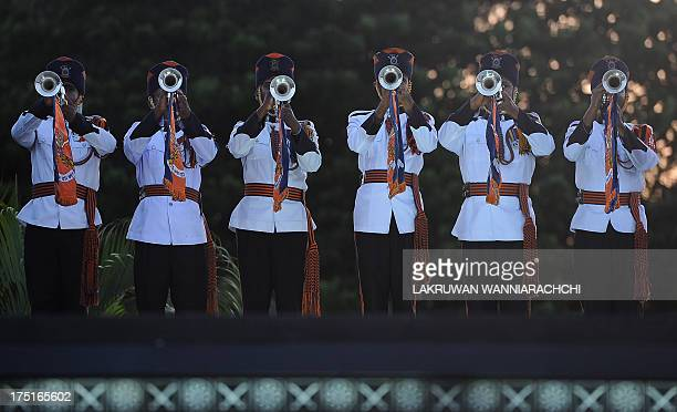 Sri Lankan Army buglers play at the War Hero's memorial in Colombo on August 1 2013 Major General Daya Ratnayake will be the country's 20th army...