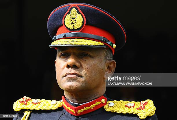 Sri Lankan Army Commander Major General Daya Ratnayake attends a parade during the army's 64th anniversary and Army Day ceremony in Colombo on...
