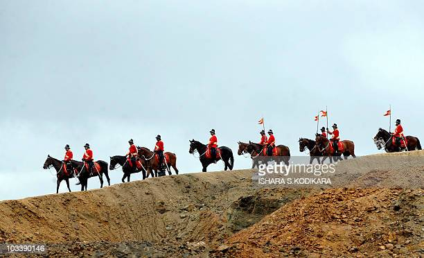 Sri Lankan army horsemen ride atop the sea wall of the port of Hambantota on August 15 after escorting President Mahinda Rajapakse to the site...
