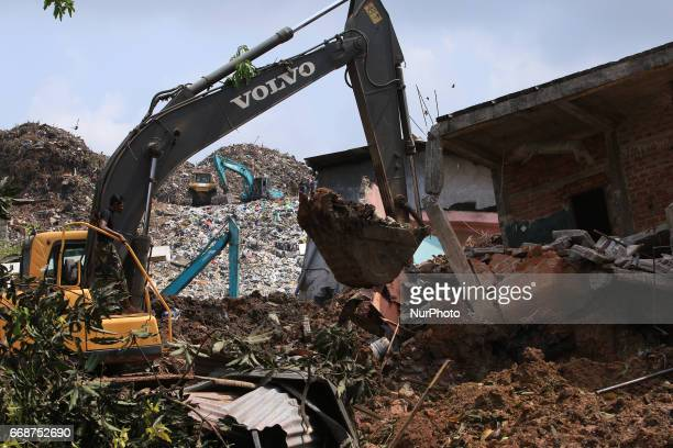 Sri Lankan Army personal use heavy machinery during rescue operations at the collapsed garbage mountain in Colombo Sri Lanka 15 April 2017 A large...