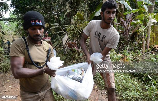 Sri Lankan Army personnel distribute food to flood victims in Molkawa in the district of Kalutara on May 30 2017 Sri Lanka appealed May 30 for...