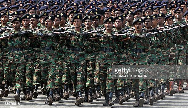 Sri Lankan Army personnel march during a Victory Day parade in Colombo on May 18 2013 Sri Lanka celebrates War Heroes month with the parade which...