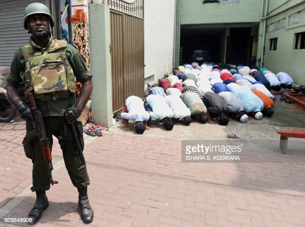 A Sri Lankan army soldier guards a mosque in Sri Lankas capital Colombo on March 9 amid fears that antiMuslim riots in the central region of Kandy...