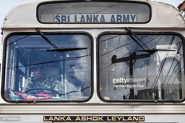 Sri Lankan army soldier is seen waiting at a traffic light in downtown Jaffna city The military presence is still very much a common site Paula...