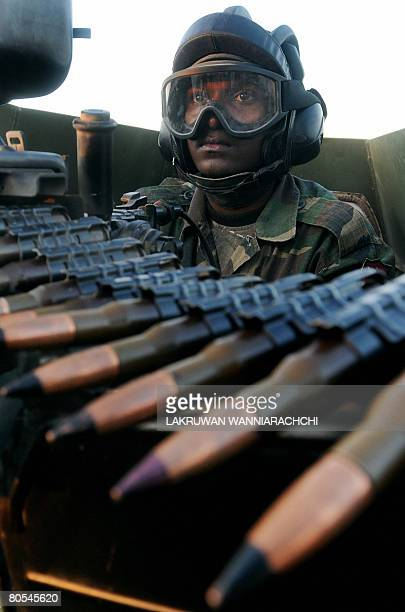 A Sri Lankan Army soldier patrols along the 'de facto' frontline at Nager Kovil in the Jaffna Peninsula some 400 kms north of Colombo on April 6 2008...