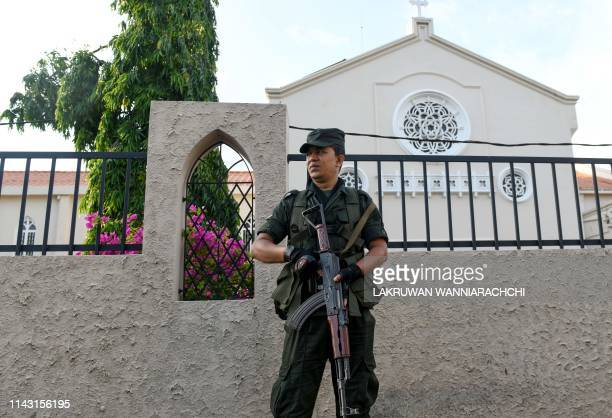 A Sri Lankan Army soldier stands guard outside the St Theresa's church as the Catholic churches hold services again after the Easter attacks in...