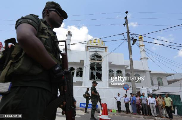 Sri Lankan Army soldiers guard the entrance near a Muslim masjid following sectarian clashes in the city of Minuwangda 44 kilometers from Colombo Sri...