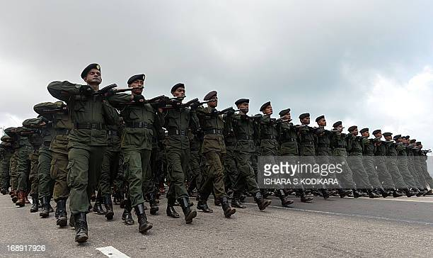 Sri Lankan Army soldiers march during a Victory Day parade rehearsal in Colombo on May 17 2013 Sri Lanka celebrates War Heroes month with a military...