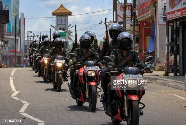 Sri Lankan Army soldiers ride motor bikes in the streets following sectarian clashes in the city of Minuwangda 44 kilometers from Colombo Sri Lanka...