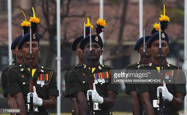 Sri Lankan Army soldiers stand at attention during a visit by Pakistani Army Chief General Ashfaq Parvez Kayani at the Army headquarters in the...