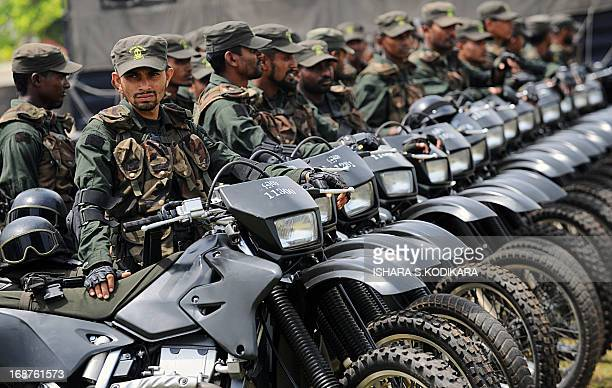 Sri Lankan army Special Force commando soldiers looks on during a Victory Day parade rehearsal in Colombo on May 15 2013 Sri Lanka celebrates War...