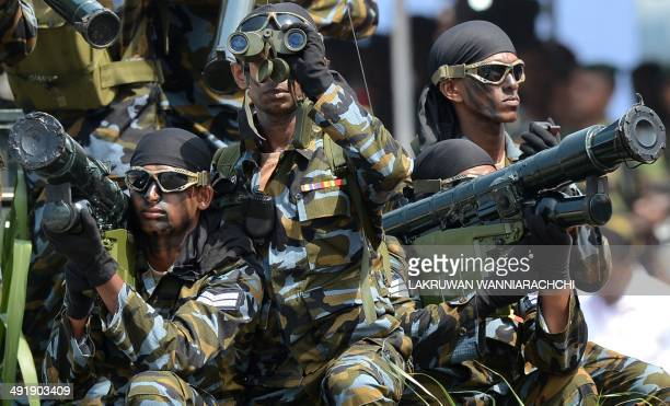 Sri Lankan army Special Force commando soldiers participate in a Victory Day parade in the southern town of Matara on May 18 2014 The government is...
