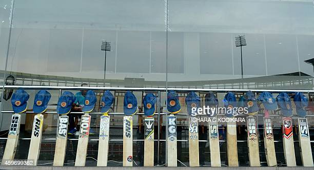 Sri Lankan bats and caps are lined up in tribute to young Australian batsman Phillip Hughes who died after being hit by a ball during a domestic...