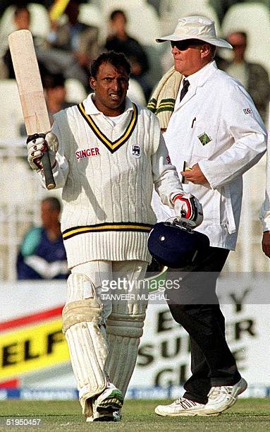 Sri Lankan batsman Aravinda de Silva waves his bat after completing his century on the second day of the first cricket Test at Rawalpindi 27 February...