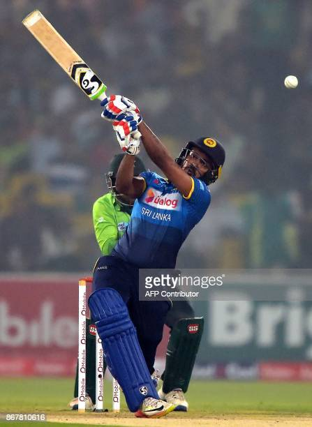 Sri Lankan batsman Danushka Gunathilaka plays a shot during the third and final T20 cricket match between Pakistan and Sri Lanka at the Gaddafi...