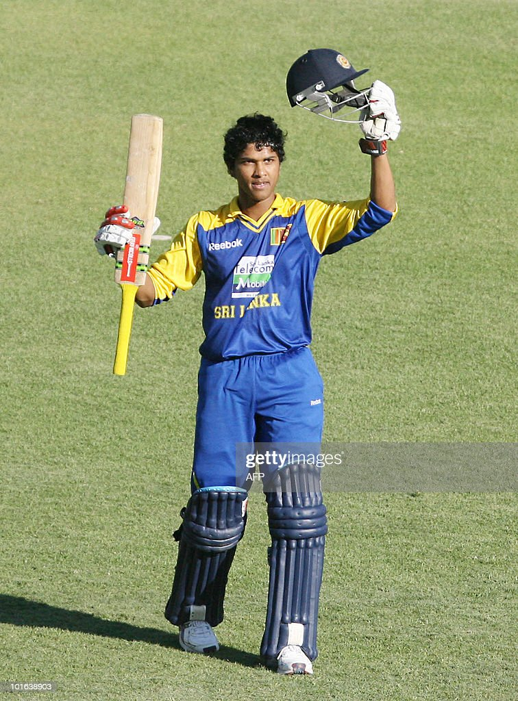 Sri Lankan batsman Dinesh Chandimal celebrates after reaching a century against India at the Harare Sports Club on June 5,2010 in the fifth match of the Micromax Cup Triangular One-Day series, which is being hosted by Zimbabwe.