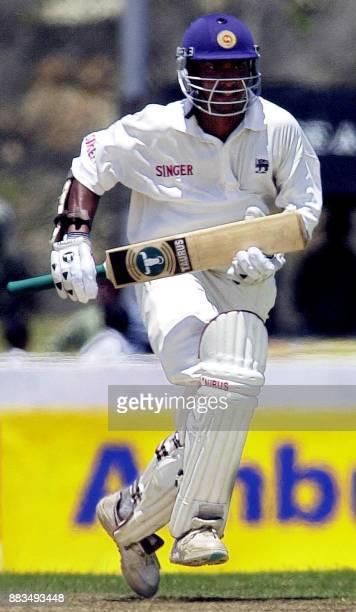 Sri Lankan batsman Kumar Sangakkara takes a run on the way to scoring an unbeaten 82 runs by lunch on the third day of the first test match between...